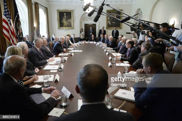 US President Donald Trump center left speaks during a meeting with Cabinet members at the White House in Washington DC US on Monday June 12 2017 US...