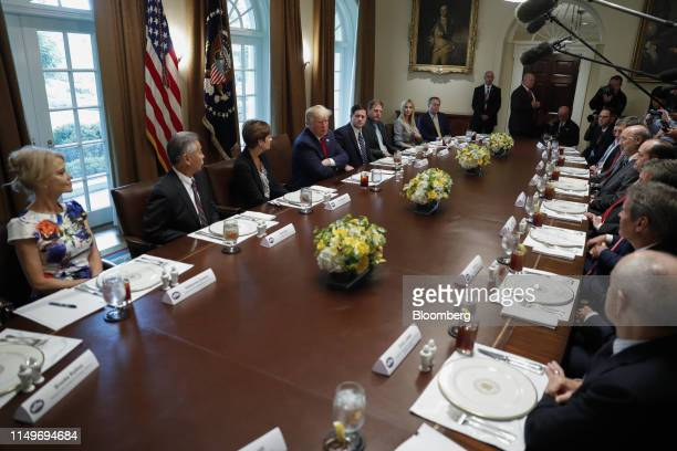 US President Donald Trump center left speaks during a working lunch with governors on workforce freedom and mobility in the Cabinet Room of the White...