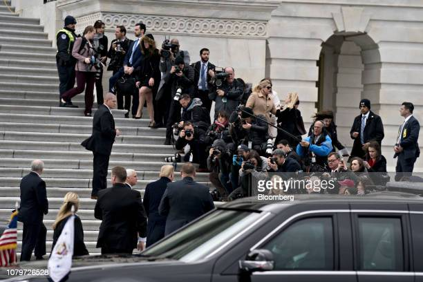 US President Donald Trump center left speaks to members of the media while arriving to the US Capitol for a meeting with Senate Republicans with US...