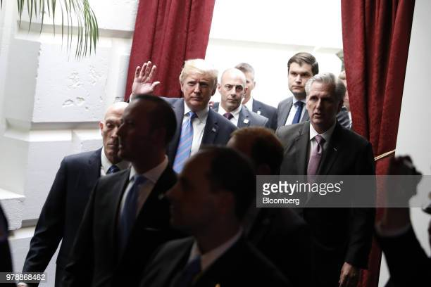 US President Donald Trump center left waves while walking with House Majority Leader Kevin McCarthy a Republican from California as Democratic...