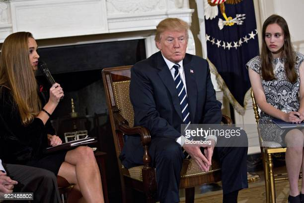 US President Donald Trump center listens as Julia Cordover Parkland student body president left speaks during a listening session on gun violence...