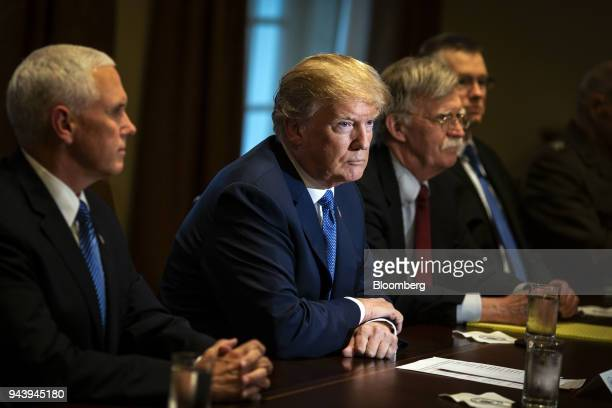 US President Donald Trump center listens during a meeting with senior military leadership in the Cabinet Room of the White House in Washington DC US...