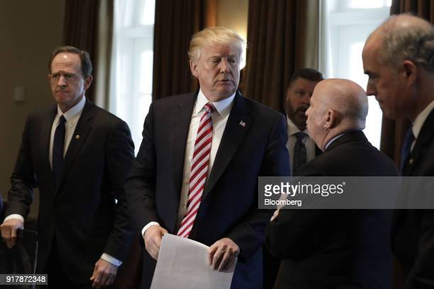 US President Donald Trump center listens to Representative Kevin Brady a Republican from Texas second right while leaving a meeting with bipartisan...