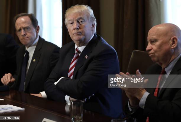 US President Donald Trump center listens while Representative Kevin Brady a Republican from Texas right applauds during a meeting with bipartisan...