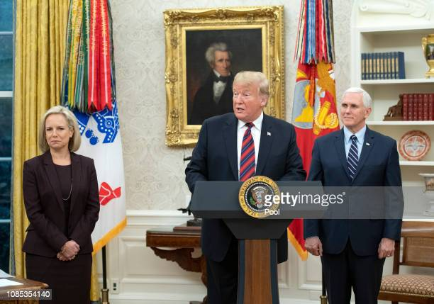 S President Donald Trump center makes remarks as he hosts a naturalization ceremony in the Oval Office of the White House in Washington DC January 19...