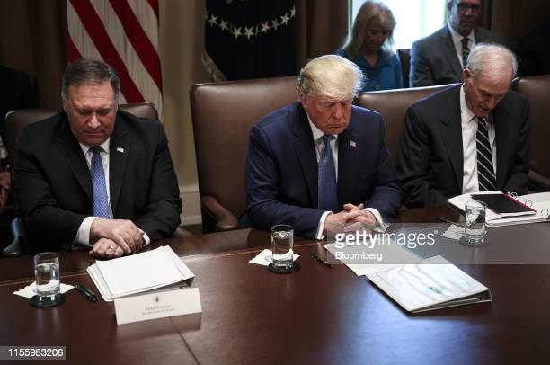 US President Donald Trump center Mike Pompeo US secretary of state left and Richard Spencer acting US Secretary of Defense pray before the start of a...