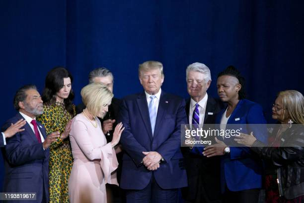 S President Donald Trump center prays during an 'Evangelicals for Trump' Coalition launch event in Miami Florida US on Friday Jan 3 2020 Monday...