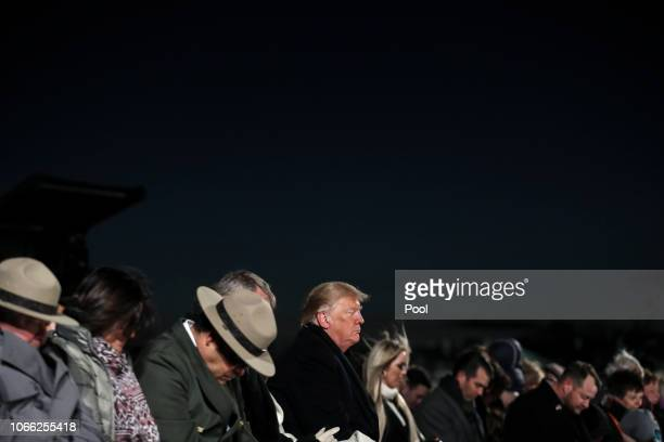 President Donald Trump center prays during the National Christmas Tree lighting ceremony held by the National Park Service at the Ellipse near the...