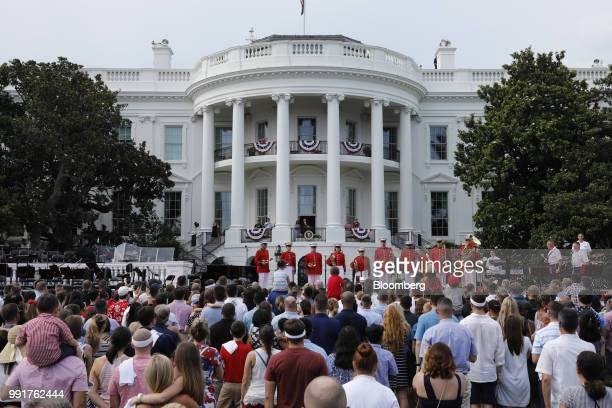 US President Donald Trump center right and First Lady Melania Trump center left attend a picnic for military families in Washington DC US on...