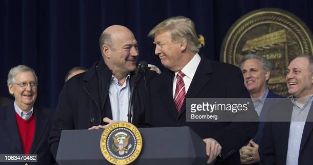 S President Donald Trump center right and Gary Cohn director of the US National Economic Council center left smile during a press conference with...
