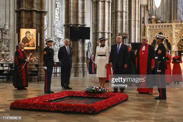 US President Donald Trump center right and US First Lady Melania Trump lay a wreath at the Grave of the Unknown Warrior as Prince Andrew the Duke of...