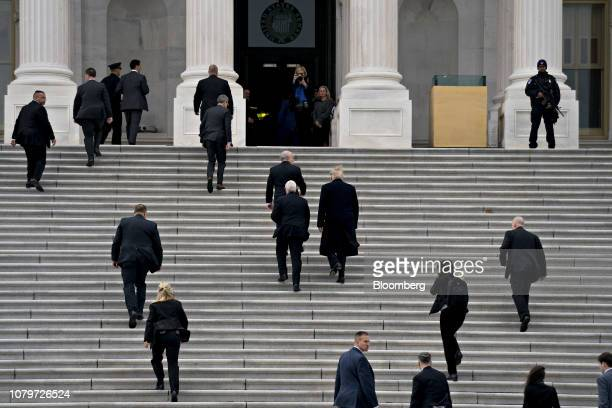 US President Donald Trump center right and US Vice President Mike Pence center left arrive to the US Capitol for a meeting with Senate Republicans in...