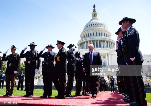 US President Donald Trump center right arrives during the 38th annual National Peace Officers Memorial Day service at the US Capitol in Washington DC...