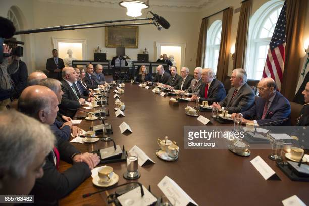 US President Donald Trump center right speaks as Haider alAbadi Iraq's prime minister center left listens during a meeting at the White House in...
