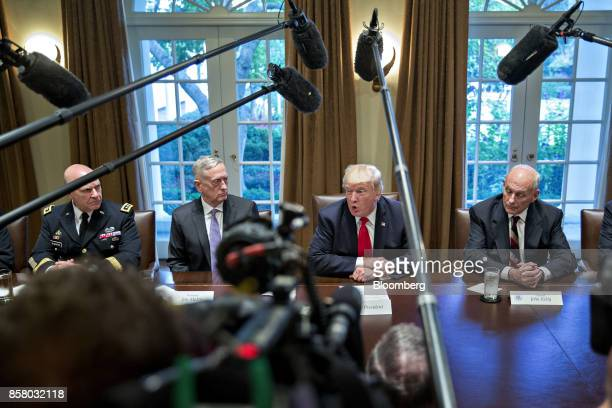 US President Donald Trump center right speaks as John Kelly White House chief of staff right and HR McMaster national security advisor left and Jim...