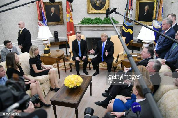 US President Donald Trump center right speaks as US Pastor Andrew Brunson center left his wife Norine Brunson left and Mike Pompeo US secretary of...