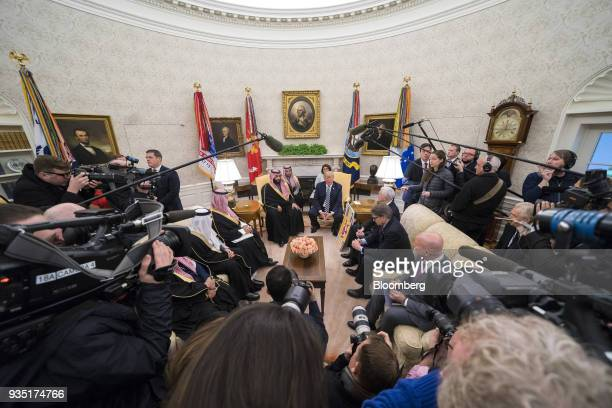 US President Donald Trump center right speaks while Mohammed bin Salman Saudi Arabia's crown prince center left listens during a meeting in the Oval...