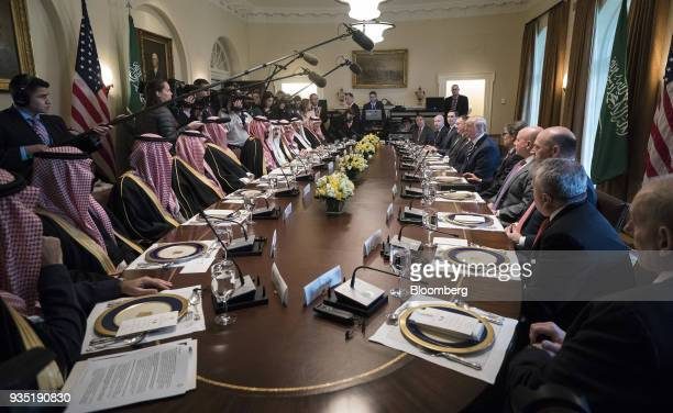 US President Donald Trump center right speaks while Mohammed bin Salman Saudi Arabia's crown prince center left listens during a working lunch in the...
