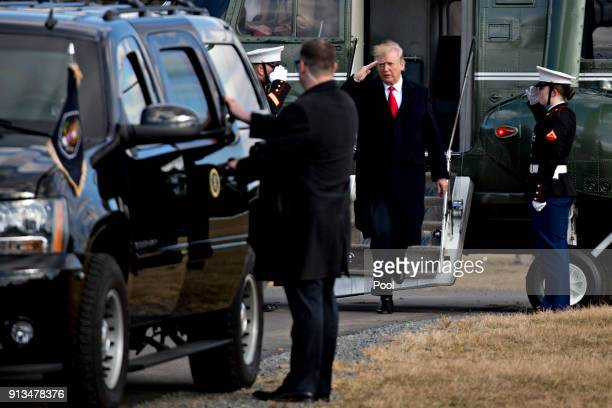 US President Donald Trump center salutes while walking off Marine One after landing at Paul Hencken Soccer Fields before visiting the Customs and...