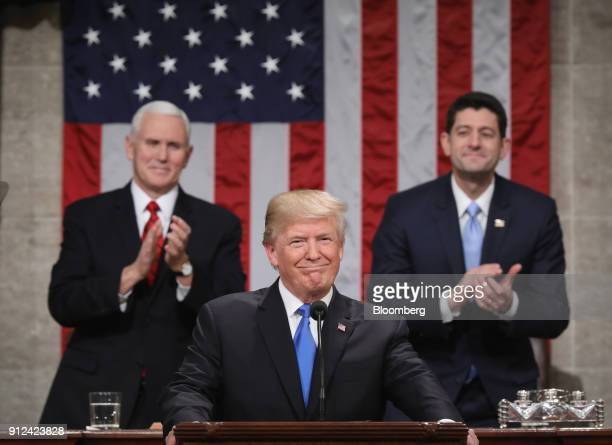 US President Donald Trump center smiles before delivering a State of the Union address to a joint session of Congress at the US Capitol in Washington...
