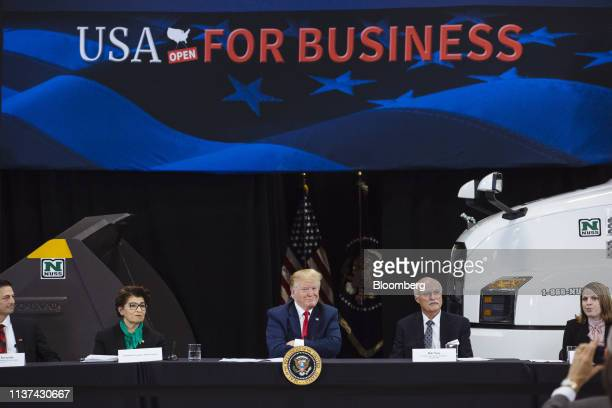 US President Donald Trump center smiles during a roundtable discussion on the economy and tax reform in Burnsville Minnesota US on Monday April 15...