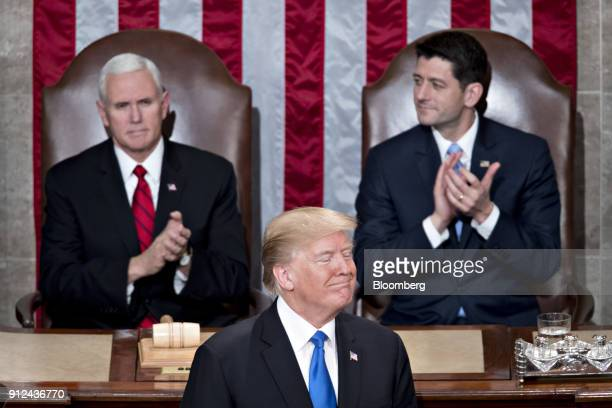 US President Donald Trump center smiles while delivering a State of the Union address to a joint session of Congress at the US Capitol in Washington...