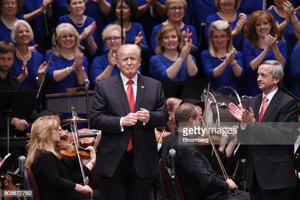 US President Donald Trump center speaks and pastor Robert Jeffress right applaud during the Celebrate Freedom event at the John F Kennedy Center for...