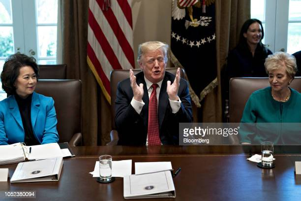 US President Donald Trump center speaks as Elaine Chao US secretary of transportation left and Linda McMahon administrator of the Small Business...