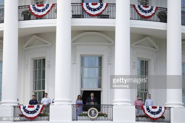US President Donald Trump center speaks as First Lady Melania Trump center left looks on at a picnic for military families in Washington DC US on...