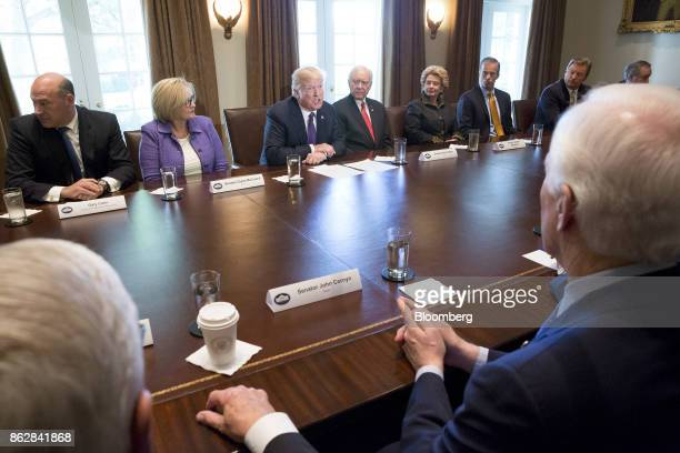 US President Donald Trump center speaks as Gary Cohn director of the US National Economic Council from top left Senator Claire McCaskill a Democrat...