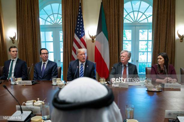 President Donald Trump center speaks as he meets with the Emir of Kuwait Jaber AlAhmad AlSabah in the Cabinet Room of the White House on September 5...