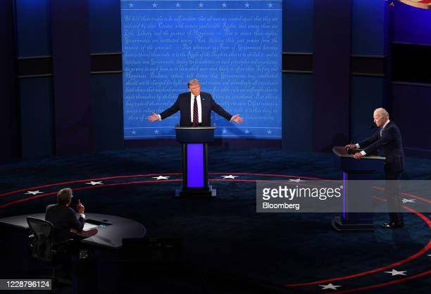 President Donald Trump, center, speaks as Joe Biden, 2020 Democratic presidential nominee, right, listens during the first U.S. Presidential debate...