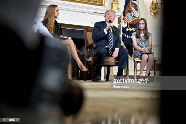 US President Donald Trump center speaks as Julia Cordover Parkland student body president left and Carson Abt a student from Marjory Stoneman Douglas...