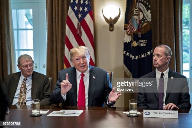 US President Donald Trump center speaks as Representative Mac Thornberry a Republican from Texas right and Senator James Inhofe a Republican from...