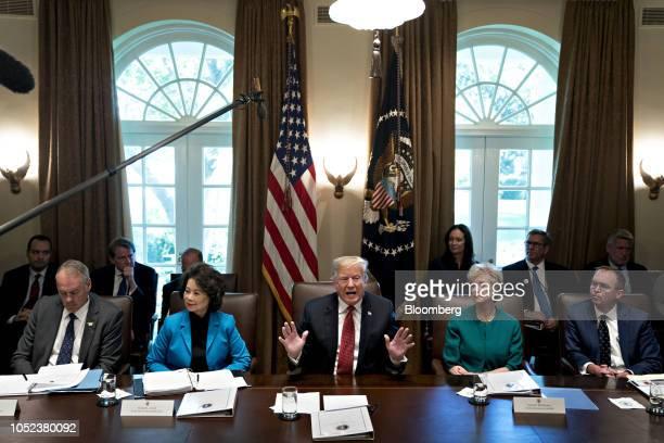 US President Donald Trump center speaks as Ryan Zinke US secretary of interior from left Elaine Chao US secretary of transportation Linda McMahon...