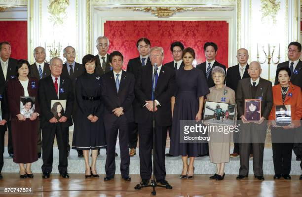 US President Donald Trump center speaks as US First Lady Melania Trump center right Shinzo Abe Japan's prime minister center left and Akie Abe wife...