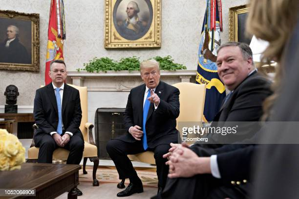 US President Donald Trump center speaks as US Pastor Andrew Brunson left and Mike Pompeo US secretary of state right listen during a meeting in the...