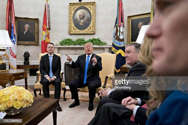 US President Donald Trump center speaks as US Pastor Andrew Brunson left and Mike Pompeo US secretary of state second right listen during a meeting...