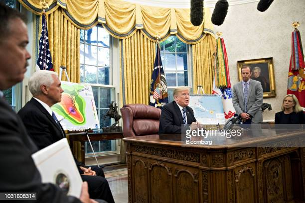US President Donald Trump center speaks as US Vice President Mike Pence from second left Brock Long administrator of the Federal Emergency Management...