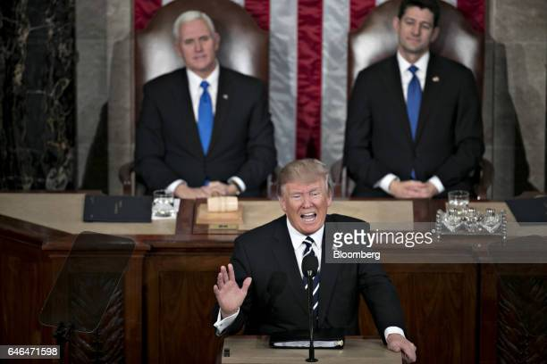 US President Donald Trump center speaks as US Vice President Mike Pence left and US House Speaker Paul Ryan a Republican from Wisconsin listen during...