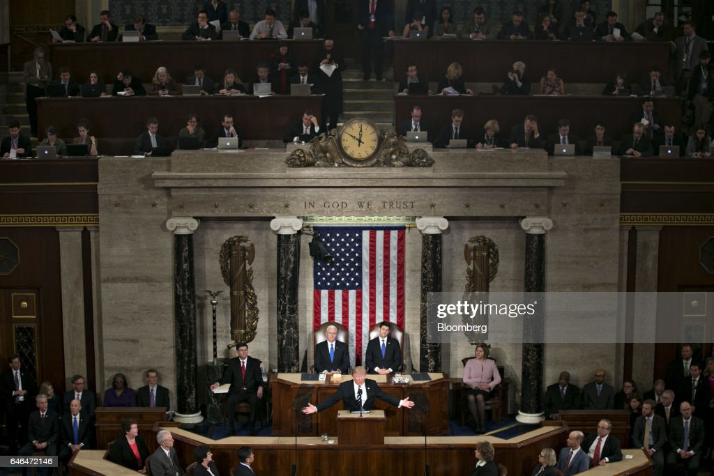 U.S. President Donald Trump, center, speaks as U.S. Vice President Mike Pence, left, and U.S. House Speaker Paul Ryan, a Republican from Wisconsin, listen during a joint session of Congress in Washington, D.C., U.S., on Tuesday, Feb. 28, 2017. Trump will press Congress to carry out his priorities for replacing Obamacare, jump-starting the economy and bolstering the nations defenses in an address eagerly awaited by lawmakers, investors and the public who want greater clarity on his policy agenda. Photographer: Andrew Harrer/Bloomberg via Getty Images