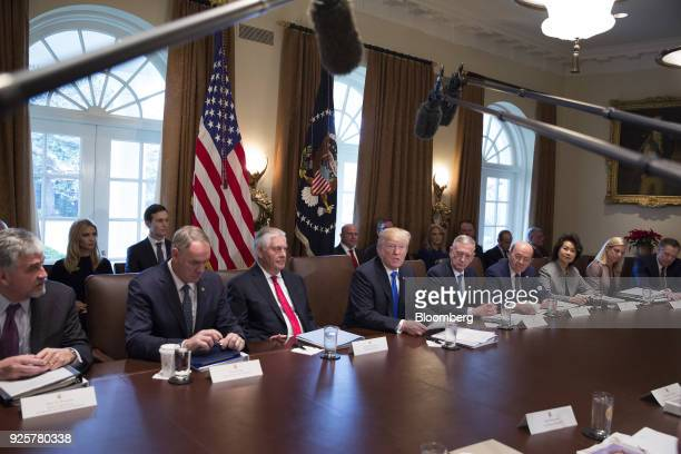 S President Donald Trump center speaks during a cabinet meeting at the White House as Ivanka Trump assistant to the US President and her husband...