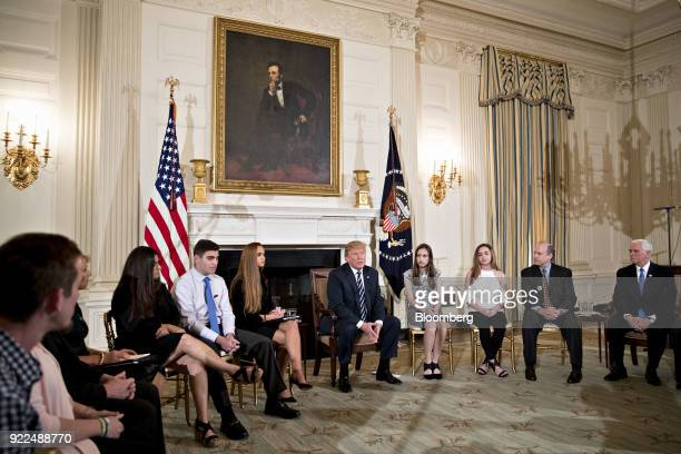 US President Donald Trump center speaks during a listening session on gun violence with high school students teachers and parents in the State Dining...