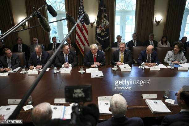 US President Donald Trump center speaks during a meeting in the Cabinet Room of the White House in Washington DC US on Thursday Aug 16 2018...