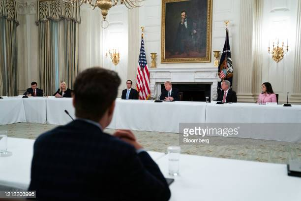 President Donald Trump, center, speaks during a meeting with Republican members of Congress in Washington, D.C., U.S., on Friday, May 8, 2020....