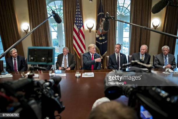 US President Donald Trump center speaks during a meeting with Republican members of Congress in the Cabinet Room of the White House in Washington DC...