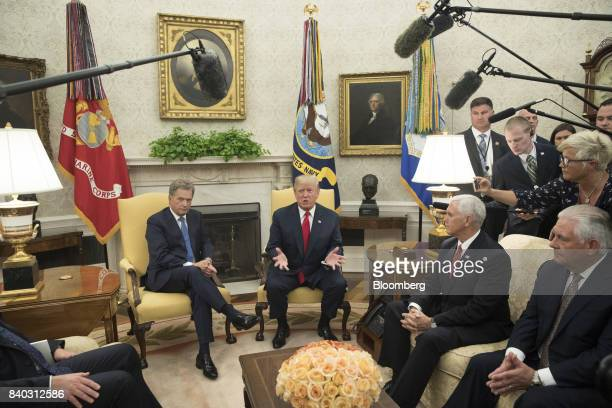 US President Donald Trump center speaks during a meeting with Sauli Niinisto Finland's president left in the Oval Office of the White House in...