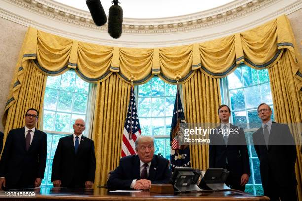 President Donald Trump, center, speaks during a press conference on Israel and Bahrain establishing full diplomatic ties in the Oval Office of the...
