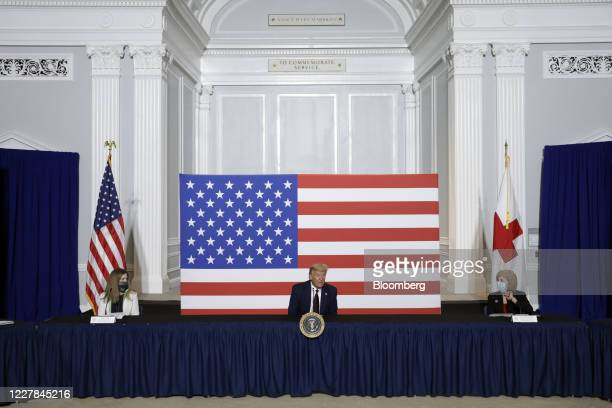 President Donald Trump, center, speaks during a roundtable discussion while visiting the American Red Cross National Headquarters in Washington,...