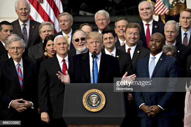 US President Donald Trump center speaks during a tax bill passage event with Republican congressional members of the House and Senate on the South...